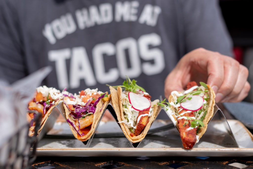 person eating tacos